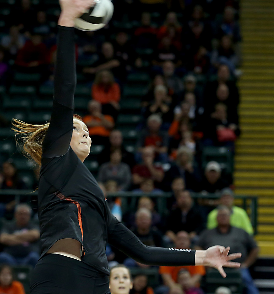 E.L. Hubbard / Special to GateHouse Ohio Media<br /> Dalton MH Emma Granger tries for a kill against Jackson Center during their Division IV semifinal at Wright State's Nutter Center in Fairborn Friday, Nov. 11, 2016.