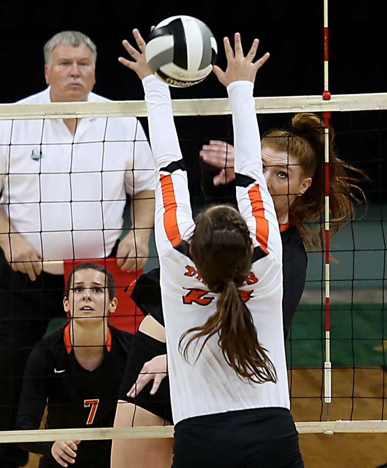 E.L. Hubbard / Special to GateHouse Ohio Media<br /> Dalton MH Emma Granger spikes the ball against Jackson Center's Camryn Hoehne during their Division IV semifinal at Wright State's Nutter Center in Fairborn Friday, Nov. 11, 2016.