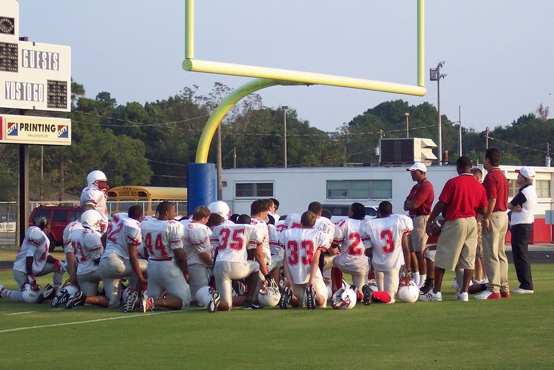 The team in prayer before the game