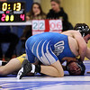 HADLEY GREEN/ Staff photo<br /> Danvers' Devin Viel pushes up off the mat as Lynnfield/North Reading's Adam Rossetti leans on top during the 132 pound match at Wednesday night's wrestling match hosted by Danvers High.