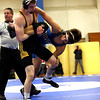 HADLEY GREEN/ Staff photo<br /> Danvers' Matt Reidy grapples with Lynnfield/North Reading's Connor Stead during the 152 pound match at Wednesday night's wrestling match hosted by Danvers High.