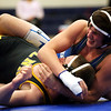 HADLEY GREEN/ Staff photo<br /> Danvers' Colby Holland goes up against Lynnfield/North Reading's Dan Ryan during the 145 pound match at Wednesday night's wrestling match hosted by Danvers High.