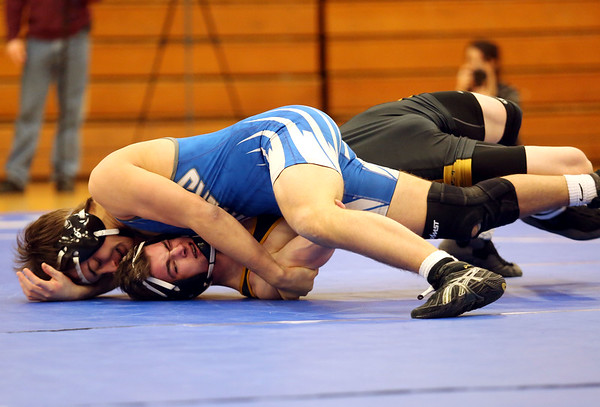 HADLEY GREEN/ Staff photo<br /> Danvers' Matt Reidy pushes Lynnfield/North Reading's Connor Stead to the mat during the 152 pound match at Wednesday night's wrestling match hosted by Danvers High.