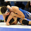HADLEY GREEN/ Staff photo<br /> Danvers' Russ Canova grapples with Lynnfield/North Reading's Eric Benecke during the 182 pound match at Wednesday night's wrestling match hosted by Danvers High.