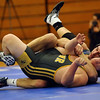 HADLEY GREEN/ Staff photo<br /> Danvers' Quinn Holland tries to pin with Lynnfield/North Reading's Andrew DiPietro to the mat during the 182 pound match at Wednesday night's wrestling match hosted by Danvers High.