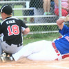 6-25-14<br /> Hollingsworth Lumber vs. Martin Brothers<br /> Hollingsworth Lumber's Matt McCauley makes the slide into home before Martin Brothers' Alex Kirk can tag him out.<br /> Kelly Lafferty | Kokomo Tribune
