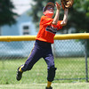 6-21-14<br /> David A. Kasey tournament<br /> Mason Morgan of White's Meat Market makes a catch in the outfield for an out.<br /> Kelly Lafferty | Kokomo Tribune