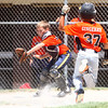 6-21-14<br /> David A. Kasey tournament<br /> Weston Gingrich of Burger King gets to home safely before Kendall Lanning of White's Meat Market tries to get him out.<br /> Kelly Lafferty | Kokomo Tribune