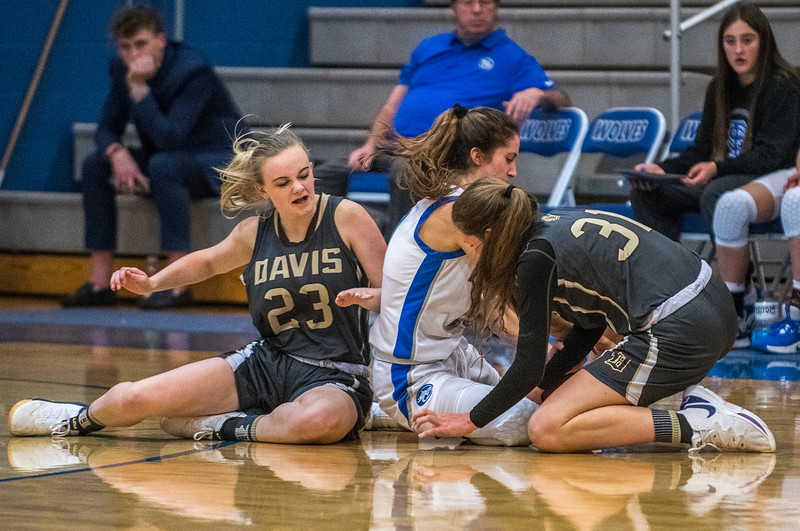 Fremont and Davis girls battle for possession during the prep basketball game. n Plain City, on Friday January 3, 2020.