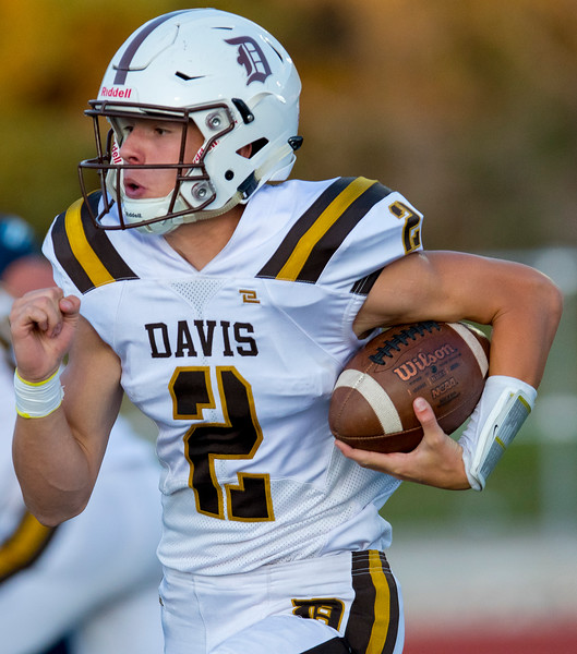 Quarterback Chance Trujillo (2) of Davis decides to run against Layton's pass offense, In Layton on Friday September 13, 2019.