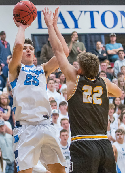 Boston Painter (25) of Layton High school shoots the fade away jumper as Jax Pearce (22) tries to disrupt the shot. On Friday January 17, 2020. In Layton.