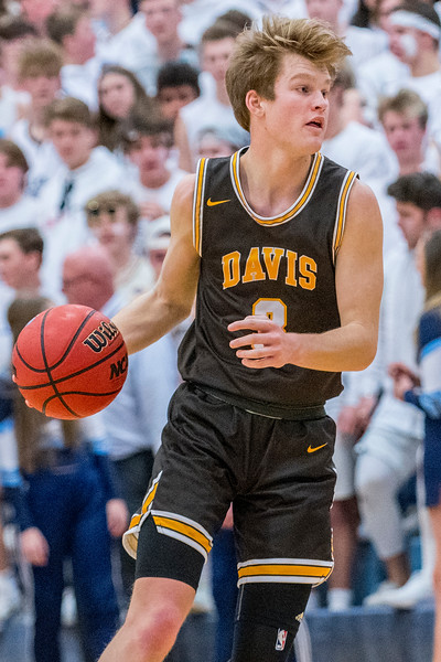 Davis guard Jake Sampson (3) assess Layton's defense and passes to his teammate, during the boys prep basketball game. At Layton High School, on Friday January 17, 2020.
