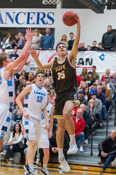 Davis forward Dylan Perrenoud (35) makes a move to the hoop  as the Layton defenders close in. On Friday January 17, 2020. In Layton.