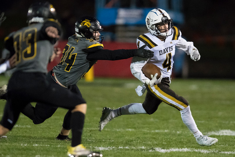David Spjut (4) of Davis outruns the Roy defense, during the prep football game. In Roy on Friday September 20, 2019.