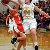 John Cross<br /> Mankato East's Claire Ziegler goes up to block a shot by Mankato West's Emily Veroeven.