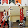 Pat Christman<br /> Mankato East's Nic Seiler is too late to block a three point shot by Mankato West's Steven Nessler during the first half Saturday.