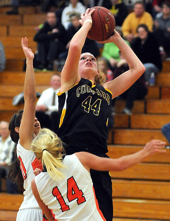 Mankato East's Claire Ziegler shoots over a pair of Marshall defenders during the first half Saturday at the East gym.