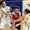 Mankato Loyola's Elizabeth Ninneman (center) tries to take the ball from Waterville-Elysian-Morristown's Nicole Dahle (left) and Brooke Galler during the first half of the championship game in the Crusader Classic basketball tournament Saturday at the Fitzgerald gym.