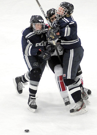 Mankato West's Max Mettler gets sandwiched between a pair of Rochester Century defenders after passing the puck during the first period Saturday at All Seasons Arena.