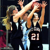 St. Clair's Bethany Reuter (left) and Kelsey Linnell put pressure on Tri City United's Coley Selly during the first half Thursday at the St. Clair Holiday Classic basketball tournament in St. Clair.
