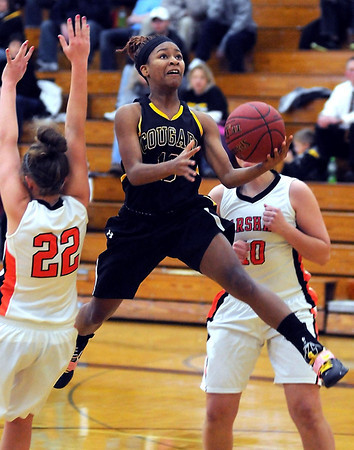 Mankato East's Minnie Frederick leaps toward the basket during the first half of their game against Marshall Saturday at the East gym.