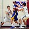 Maple River's Payton See (2) and Cory Schiefelbein (1) surround Mankato Loyola's Connor Tanhoff during the first half Thursday at the Pepsi Holiday Basketball Tournament at Bethany Lutheran College.