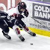 Rochester Century's Samuel Batterson chases down Mankato West's Tyler Loe during the first period Saturday at All Seasons Arena.