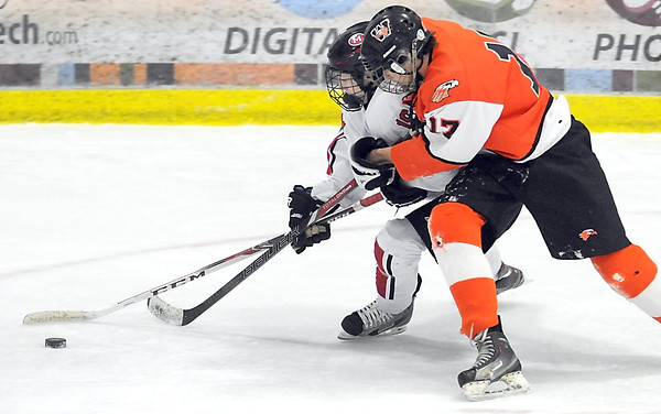 Pat Christman<br /> Mankato West's Austin Langworthy tries to get around Winona's John Rickoff during the second period Saturday at All Seasons Arena.
