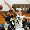Pat Christman<br /> Mankato East's C.J. Ayers shoots around Rochester Mayo's Dan Jech during the first half Friday at the East gym.