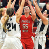 Pat Christman<br /> Manakto West's Lauren Resner draws a crowd of Faribault defenders during the second half Friday at the West gym.