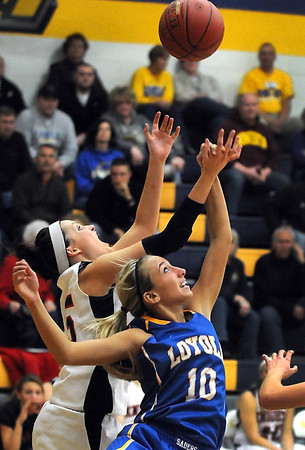 Pat Christman<br /> Mankato Loyola's Jordyn Strachan (10) and Alden-Conger's Toni Chicos reach for a rebound during the first half Thursday at the Fitzgerald gym.