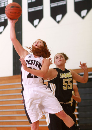 12-18-13<br /> Western vs Lebanon girls basketball<br /> Western's Carley O'Neal gets past Lebanon's Peyton Terrill.<br /> KT photo | Kelly Lafferty