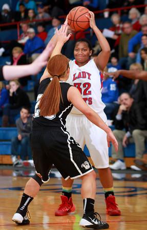 12-10-13<br /> Kokomo vs. Western basketball<br /> Kokomo's Jasmine Love looks for a pass as Western plays defense.<br /> KT photo | Kelly Lafferty