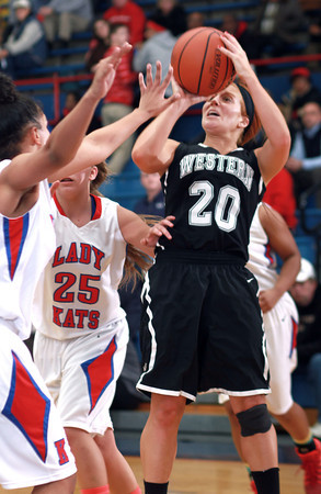 12-10-13<br /> Kokomo vs. Western basketball<br /> Western's Caitlyn O'Neal looks to the basket as Kokomo's defense tries to block her.<br /> KT photo | Kelly Lafferty