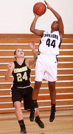 12-18-13<br /> Western vs Lebanon girls basketball<br /> Western's Raven Black goes for the basket as Lebanon's Kristen Spolyar tries to block.<br /> KT photo | Kelly Lafferty