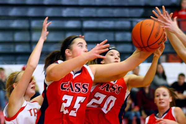 12-21-13   ---  Taylor HS vs Cass HS girls basketball --  Cass's Olivia Collins rebounding in the 3rd quarter.<br />   KT photo | Tim Bath