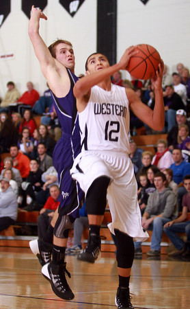 12-6-13<br /> Western vs. Northwestern HS basketball<br /> Northwestern's Evan Matlock and Western's Des Balentine<br /> KT photo | Kelly Lafferty