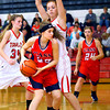 12-21-13   ---  Taylor HS vs Cass HS girls basketball  --- Cass's Bailey Gremelspacher working the ball inside with Taylor's Shannon Neal on her back.<br />   KT photo | Tim Bath