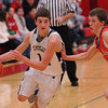 South Central's Rudy Hablewitz drives around a Flora defender in his team's loss to the top-seeded Wolves at the 41st Annual Vandalia Holiday Tournament.