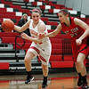 Effingham's Felicia Totten dribbles past Mt. Zion's Shannon Propst during the Hearts' 50-40 home win. <br /> Genna Ord photo