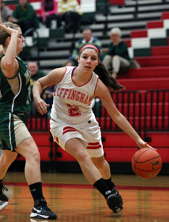 Effingham's Kelli Utz drives in toward the basket during the Hearts' 61-33 victory over Mattoon. Utz tied with teammate Josie Zerrusen for a high score of 15 points.
