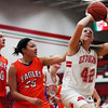 Effingham's Stephanie Robb goes up for a shot at Effingham High School.