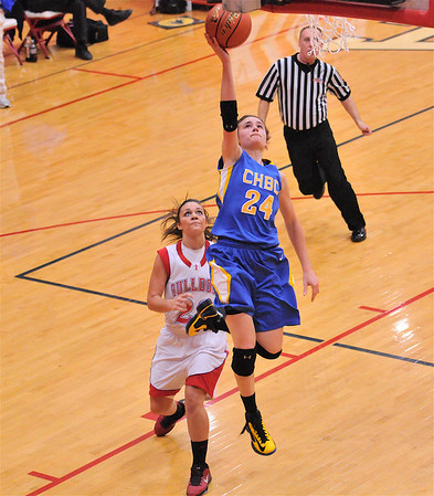Ava Paruleski drives in for a layup at the Enlow Center in her team's win against the Bulldogs.