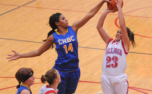 CHBC's Micah Jones blocks a shot by St. Anthony's Makayla Walsh at the Enlow Center. Jones had 19 points, 21 rebounds, seven assists and three blocks on the Lady Hornets' win.
