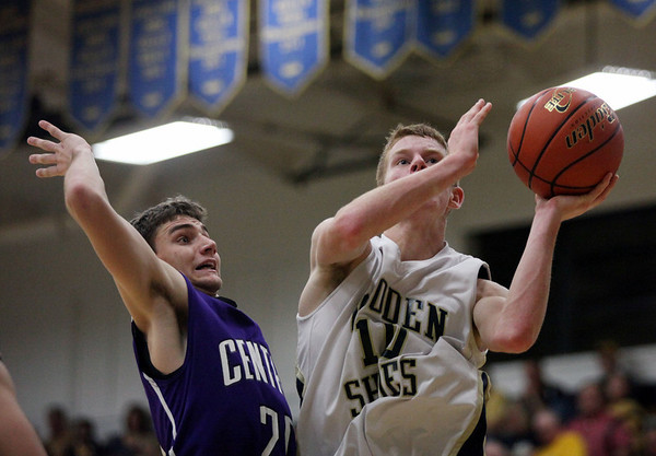 Teutopolis's Derek Smith goes for a lay-up during the Wooden Shoes' 42-49 loss to Breese Central High School. Smith was tied for the game's lead scorer with 15 points.