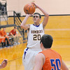 Brownstown's Matt Sefton puts up a jumper in his team's consolation semifinal win against Mulberry Grove at the St. Elmo Holiday Tournament. Sefton finished just one point shy of scoring 20-plus points for the ninth-straight time to start the season, as he finished with 19 points. St. Elmo's Connor Beasley drives to the basket in his team's semifinal win against Beecher City on Thursday at the St. Elmo Holiday Tournament.