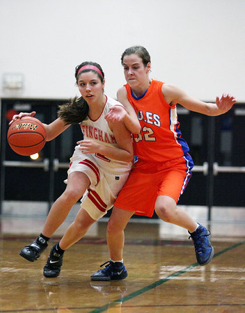 Effingham's Kelli Utz drives the ball down the court guarded by Allison Will at the Hearts' home game against the Newton Eagles.