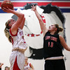 St. Anthony's Megan Nuxoll goes up for a shot as North Clay's Morgan Walker defends during the Bulldogs' 45-27 win over North Clay High School Cardinals at St. Anthony. Nuxoll was the night's top scorer with 15 points.