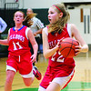 St. Anthony's Lexie Niebrugge, number 11, and Kate Richards, number 22, make their way down the court at the Girls Holiday Tournament in Mattoon.