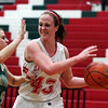 Josie Zerrusen fends off a defender during the Hearts' 61-33 home victory over Mattoon.